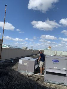 servicing commercial rooftop unit